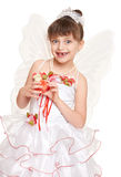 Lost tooth child dressed as tooth fairy with gifts and money Stock Image