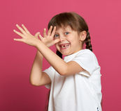 Lost tooth girl child portrait  on pink background Royalty Free Stock Image