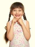 Lost tooth girl portrait, studio shoot yellow toned Stock Photo