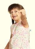 Lost tooth girl portrait, studio shoot yellow toned Royalty Free Stock Photos
