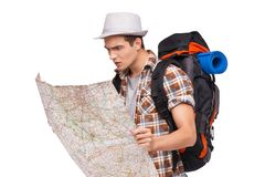 Lost tourist with map. Caucasian male hiker with travel bag looking at map Stock Photos