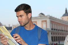 Lost tourist using map during vacation.  Stock Photo