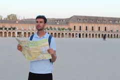 Lost tourist using map during vacation.  Stock Images
