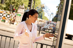 Lost tourist. Lost woman looking confused at a street map Stock Image