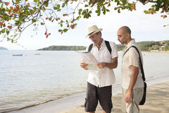 Lost tourists with map Royalty Free Stock Photo
