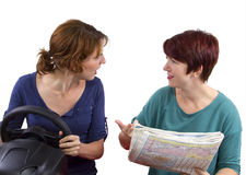 Lost Tourists. Two lost women on a journey trying to find directions Stock Image