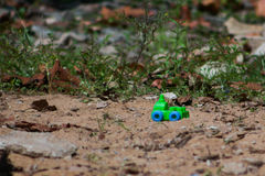 Lost toy& x27;s. A little green car Stock Photos