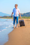 Lost traveler with suitcase Royalty Free Stock Photo