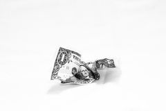 Lost value 2. A crumpled dollar bill isolated on white intended to illustrate the depreciating value of U.S. currency Stock Photography