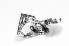 Lost value. A crumpled dollar bill isolated on white intended to illustrate the depreciating value of U.S. currency Royalty Free Stock Photo