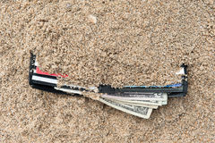 Lost wallet. A lost wallet at the beach with cash and credit cards Stock Photo
