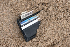 Lost wallet. A lost wallet at the beach with cash and credit cards Royalty Free Stock Photo