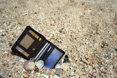 Lost wallet. Wallet found in the beach sand stock photography