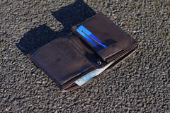 The lost wallet with cash and credit cards on the street Royalty Free Stock Photography