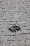 Lost wallet. Lying on the street Royalty Free Stock Image