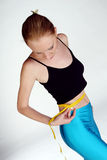 Lost weight. A shot of a girl measuring her waist Stock Images