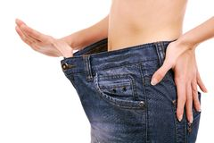 Lost weight. Conceptual image of woman showing how much weight she lost Stock Image