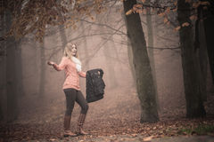 Lost woman foggy autumn park searching direction. Royalty Free Stock Photo