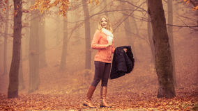 Lost woman foggy autumn park searching direction. Lost confused woman in foggy fall autumn park searching direction. Fashion young girl holding jacket. Female royalty free stock photos