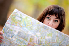 Lost woman with map Stock Images