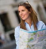Lost woman with a map Stock Images