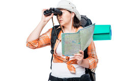 A lost woman tourist with a map and binoculars on a white. Background Royalty Free Stock Image