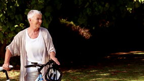 Lost woman walking with her bicycle stock footage