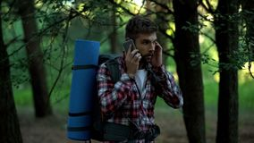 Lost in woods male camper trying to call 911, poor connection, technologies royalty free stock image