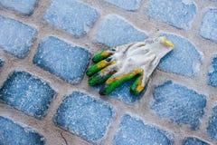 Lost working glove Stock Photo
