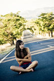 Lost young girl. Lost beautiful girl in the middle of the road Stock Photography