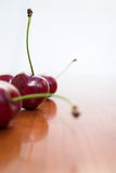 Lost yours yet?. Cherries on a table top - selective focus Stock Photo