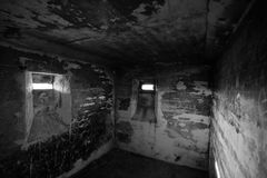 Lostau Bunker BW. View in a small confined room in an old WWII bunker near Lostau, Saxony-Anhalt, Germany. Black and white image Royalty Free Stock Images