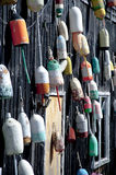 Loster Buoys on Wall. A wall full of colorful lobster buoys on Mount Desert Island in Maine Royalty Free Stock Photo