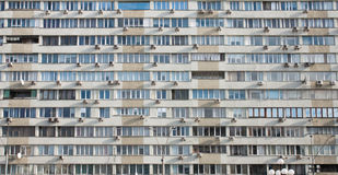 A lot of air conditioners on the facade of the building stock photography