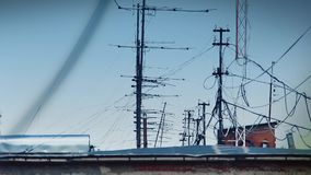 Lot of antennas on roof. Lot of antennas and wires on the hot roof stock video footage