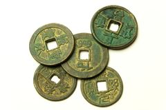 Ancient Chinese bronze coins on white background Royalty Free Stock Photography