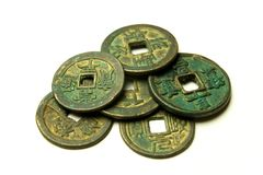 Ancient Chinese bronze coins on white background Stock Photos