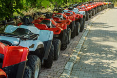 A lot of ATVs. Are on the street Stock Photo
