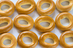 A lot of baked bagels in a raw on white background Royalty Free Stock Photos