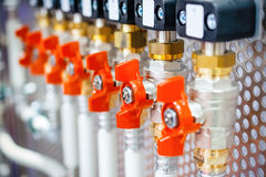 A lot of ball valves, arranged in a row. Stock Images