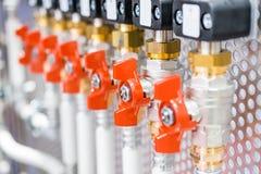 A lot of ball valves, arranged in a row. royalty free stock photos