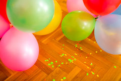 A lot of balloons on the floor. After the party stock photos
