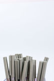 A lot of ballpoint pens on a white background. Stock Photography