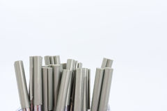 A lot of ballpoint pens on a white background. A lot of ballpoint pens on a white background stock photography