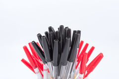 A lot of ballpoint pens on a white background. A lot of ballpoint pens on a white background royalty free stock photography