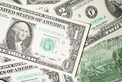 A lot of banknotes one and two US dollars Royalty Free Stock Image