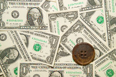 A lot of banknotes one US dollar and vintage button Royalty Free Stock Image
