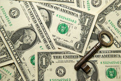 A lot of banknotes one US dollar and vintage key Royalty Free Stock Image