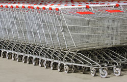 A lot of baskets on wheels for shopping Royalty Free Stock Photos