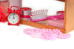 A lot of bath accessories and red alarm clock Stock Photos